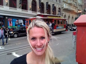 A cable car on the street in San Francisco